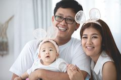 Happy asian family father mother with daughter playing with smil stock image