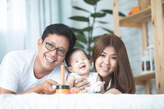 Happy asian family father mother with daughter playing with smil royalty free stock image