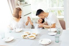 Happy Asian family of father, mother and son playing and laughin. G while having dinner Stock Photography