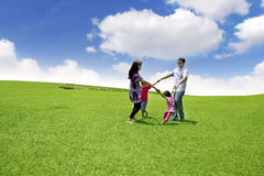 Happy Asian Family on Field. Happy asian family running in circle shot over blue sky Royalty Free Stock Photography