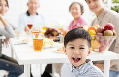 Asian family having dinner at home. Happy asian family having dinner at home Royalty Free Stock Photo