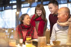 asian family having dinner and celebrating chinese new year stock images