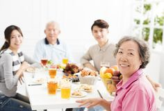 Asian family having dinner together. Happy asian family having dinner together Stock Photography