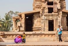 Happy asian family having fun near ancient Hindu temple Royalty Free Stock Photography
