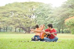 Happy Asian family having fun. stock images