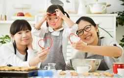Happy Asian family holding red hearts shape. stock photo