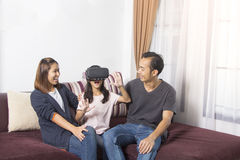 Happy asian family at home. girl playing with virtual reality Royalty Free Stock Image
