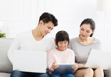 Asian family with laptop on sofa. Happy asian family with laptop on sofa Stock Photos