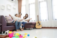 Happy asian family in living room at home. Togetherness relaxation concept royalty free stock images