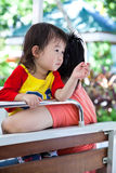 Happy asian family. Mother and daughter relaxing on a zoo bus. T Stock Photos