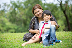 Happy Asian family ,mother with her son at park Royalty Free Stock Photo