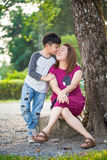Happy Asian family ,mother with her son at park. Happy Asian family ,mother and son hugging in love playing in the park stock images