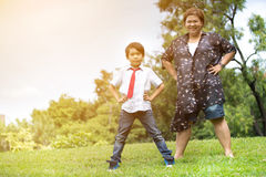 Happy Asian family ,mother with her son at park Stock Photo