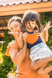 Happy Asian Family Mother Lifting Child Stock Photo