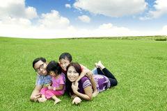 Happy Asian family outdoor. Happy family: Father, Mother, and their children. Shot outdoor in summer day Stock Images