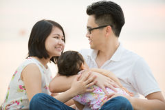 Happy Asian family at outdoor beach Stock Images