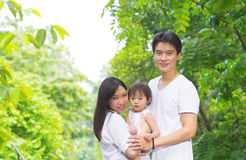 Happy Asian family outdoor portrait. Stock Images