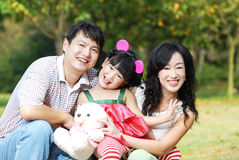 Happy asian family outdoors Royalty Free Stock Image
