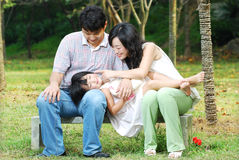 Happy asian family outdoors Stock Image