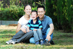 Happy asian family outdoors Stock Photography