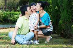Happy asian family outdoors Royalty Free Stock Photos