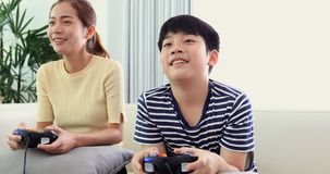 Happy asian family play game with smile face at home. Happy asian family are playing game with smile face at home. Thai sister and brother playing game together stock footage