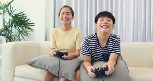 Happy asian family play game with smile face at home. Happy asian family are playing game with smile face at home. Thai sister and brother playing game together stock video