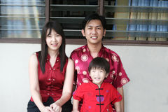 Happy Asian Family Portrait. An Asian family of a mother, father and son, pose in this outside portrait on the occasion of the Chinese New Year Stock Images