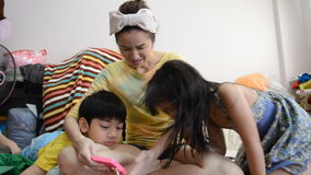 Happy Asian family relax and play with smart phone stock footage