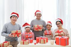 Asian Family sitting and holding the gift boxes. Royalty Free Stock Images