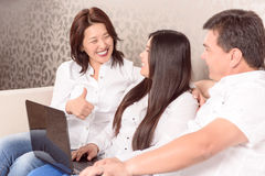 Happy Asian family  sitting at laptop Royalty Free Stock Photography