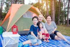 Family at camping site Royalty Free Stock Image