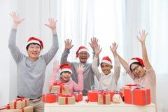 Happy Asian Family raised hands up. stock photo