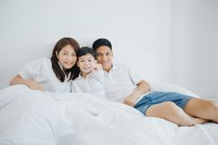 Happy Asian family with son at home on the bedroom playing and l royalty free stock photos