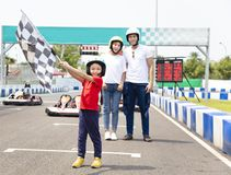 Happy family standing on the go kart race track Royalty Free Stock Photo