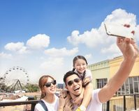 Happy family taking selfie in the park stock photos