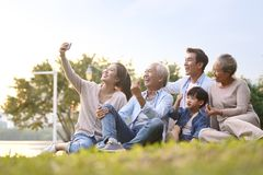 Happy asian family taking a selfie