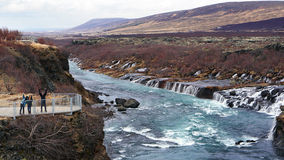 Happy Asian family tourists at hraunfossar waterfall in Iceland Stock Image