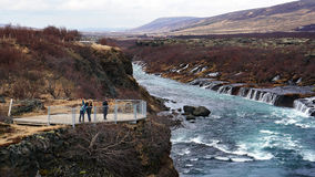 Happy Asian family travelers at hraunfossar waterfall in Iceland Stock Photography
