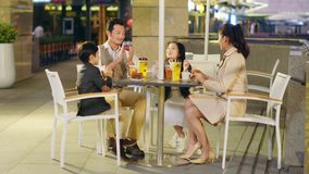 Happy asian family relaxing in coffee shop. Happy asian family with two children chatting relaxing at a coffee place stock footage