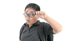 Happy asian fat boy holding magnifying glass. royalty free stock photography