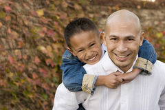 Happy Asian father and his little boy. Royalty Free Stock Photography