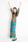 Happy Asian female arms up Stock Photo