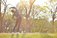 Happy Asian female workout at the park. royalty free stock images