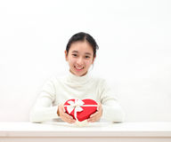 Happy asian female hands holding a gife box red heart. Happy asian female hands holding a gife box red heart royalty free stock images