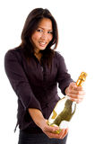 Happy asian female holding bottle Stock Image