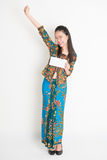 Happy Asian female showing an envelope Royalty Free Stock Images