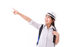 Happy asian female traveller pointing up Stock Images