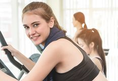 Asian Fitness women is working out in fitness gym. Happy Asian Fitness women is working out in fitness gym Stock Image