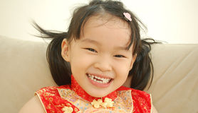 Happy Asian Girl. In beautiful red cheongsam Stock Photos